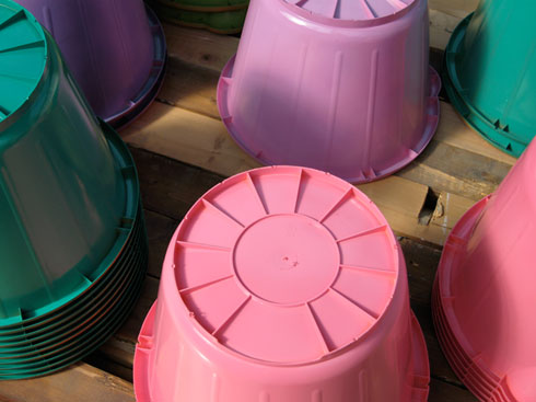 multicoloured sprayed buckets stacked upside down