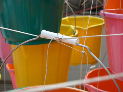 detail of buckets where tied to metal beams